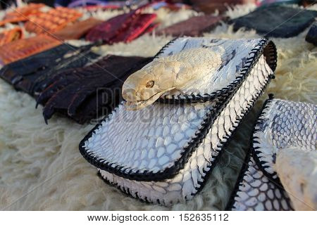 close up wallet of leather snake head skin