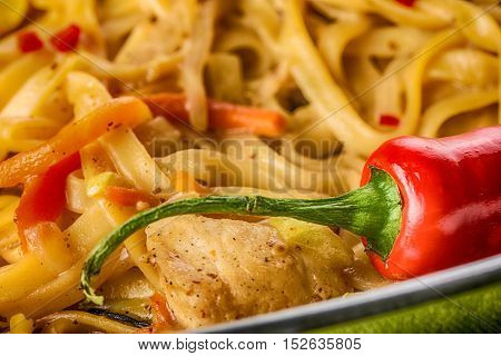 Asian noodles with mushrooms, herbs and red hot chili pepper