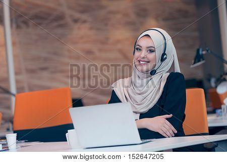 Beautiful Phone Operator Arab Woman Working In Startup Office