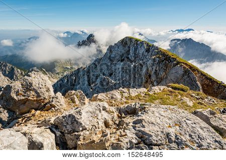 Spectacular mountain panorama, mists slowly starting to rise. Stol is the heighest peak of Karavanke in Slovenia.