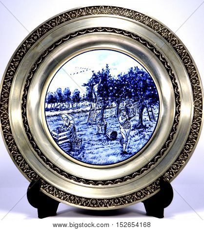 Pewter plate with a representation of the rural life.