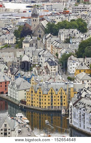 Alesund. Buidings and canal. Norwegian traditional tourist destination. Vertical