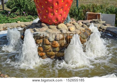 Small Fountain In The Flower Bed Area