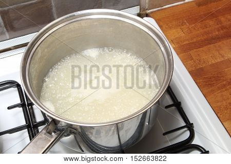 Sauce Pan Of Rice In Boiling Water On A Gas Hob