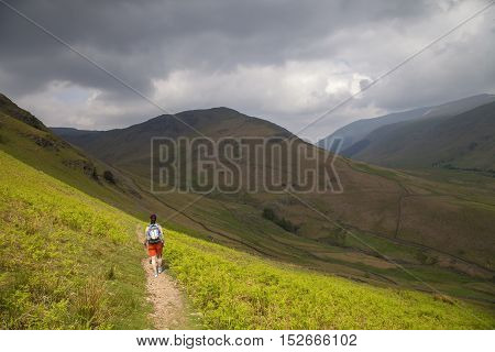 Lady walking down Helm Crag, Lake District, Cumbria, England