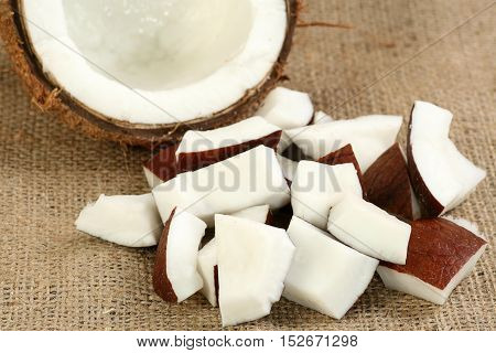 pieces of fresh coconut on a hessian background
