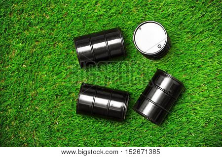High angle view on four oil drums on a grass
