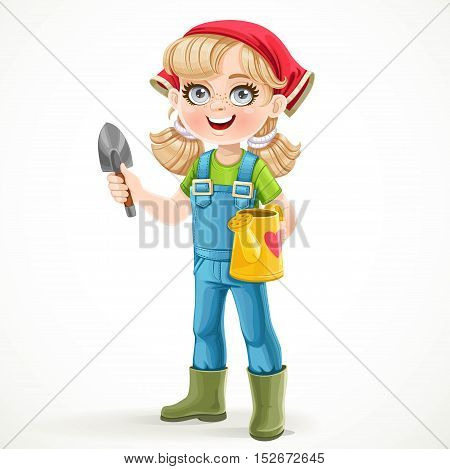 Cute little girl in jeans overalls and rubber boots holding a watering for flowers and shovel isolated on a white background