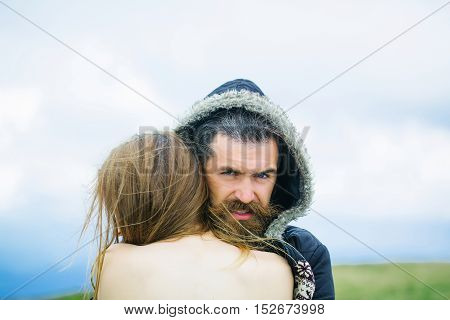 Man In Hood Hugs Girl