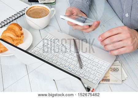 Man uses his technology accessories at the work