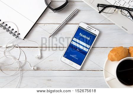 WROCLAW POLAND - OCTOBER 14th 2016: Samsung A5 with Facebook application laying on desk. Facebook is an online social media and social networking service.