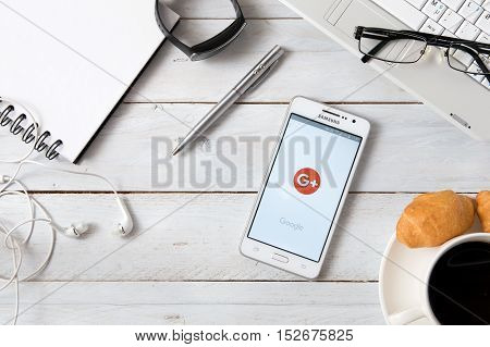 WROCLAW POLAND - OCTOBER 14th 2016: Samsung A5 with Google + application laying on desk. Google+ is an interest-based social network that is owned and operated by Google.