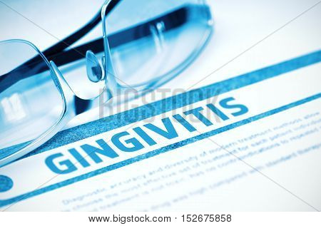 Gingivitis - Medicine Concept with Blurred Text and Pair of Spectacles on Blue Background. Selective Focus. 3D Rendering.