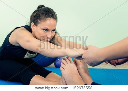 Physical therapy exercising, toned image, horizontal image