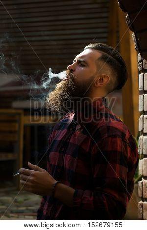 Adult Man Exhaling Cigarette Smoke