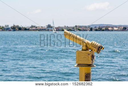 A Yellow Spotting Scope over Blue Water