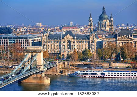 Budapest city center with Chain bridge over Danube river Gresham Hotel and St Stephen's Basilica Hungary poster