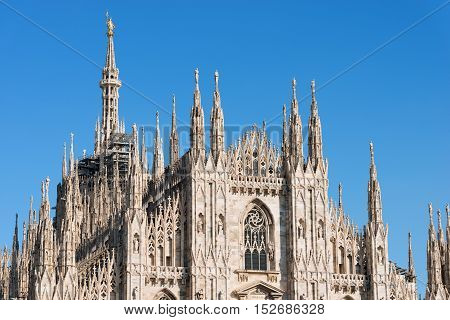 Facade of the Duomo di Milano (Milan Cathedral 1418-1577). Church monument symbol of Lombardy and of Italy