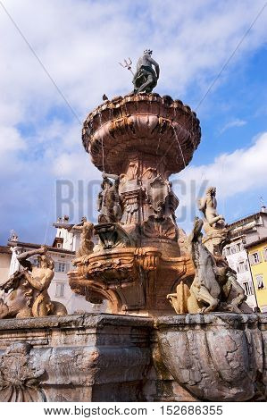 Ancient fountain of Neptune (fontana del Nettuno 1767-1769) in the square of cathedral (Piazza del Duomo) in Trento Trentino Italy