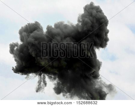 Large Very Dense Black Cloud Of The Explosion