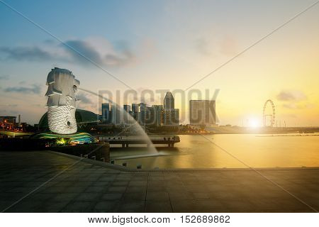 Singapore - July 12, 2015 : Merlion fountain and marina bay in the morning Singapore. Sunrise in Singapore.