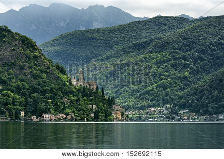 Lake of Lugano (Ceresio): Morcote (Ticino Switzerland) and the Santa Maria del Sasso church seen from the Italian coast
