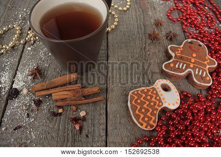Christmas gingerbread cinnamon, Christmas decorations, tea, beads, Santa's sleigh. beautiful festive dessert