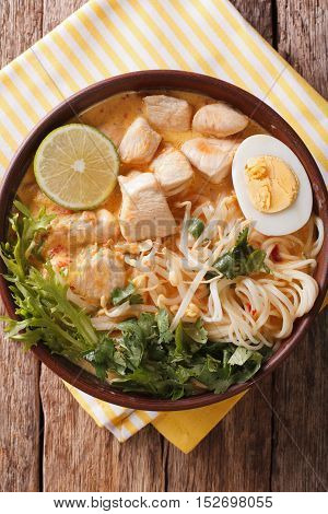 Asian Laksa Soup With Chicken, Egg, Noodles, Sprouts And Coriander. Vertical Top View