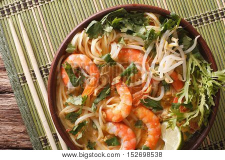Malaysian Laksa Soup With Prawns Close Up In A Bowl. Horizontal Top View