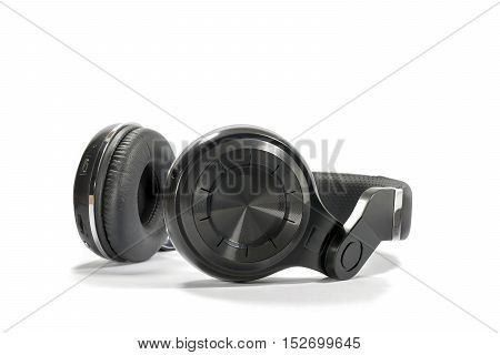 Wireless Bluetooth headphone or earphone isolated on white background.