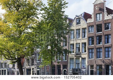 Crooked canal houses at the Keizersgracht in Amsterdam