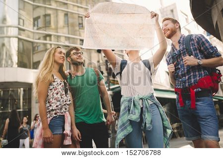 Tourist group led by tour guide on their travel poster