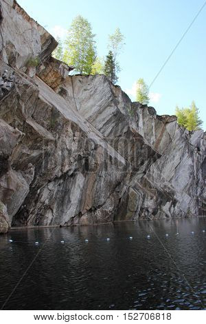 Marble quarry in Ruskeala, Karelia, Russia. View from the boat in the spring.