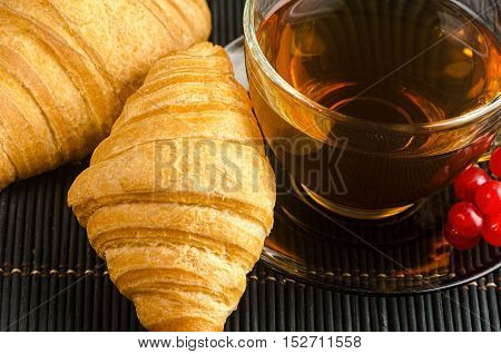 Fresh Cup Of Hot Black Tea With Croissants