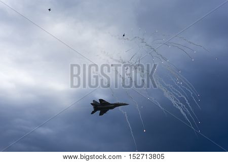 Air Strike. Fighter Jet in Dogfight. Aircraft in Battle Firing Defense Flares. War Zone.