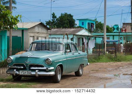 Matanzas, Cuba - September 10, 2016: Green american Chevrolet classic car parked in a sidestreet in Mantanzas Cuba - Serie Cuba 2016 Reportage