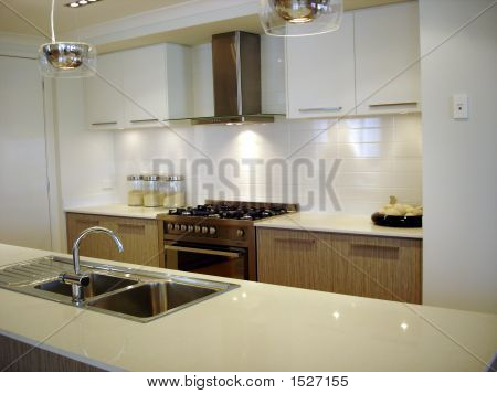 White galley style kitchen in modern home with granite benchtop and sink. poster
