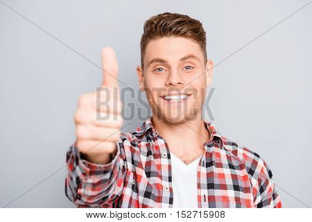 Happy Positive Young Guy Showing Thumb Up