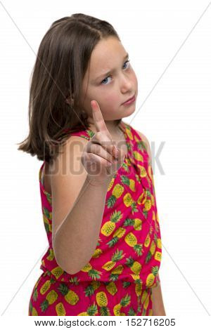 Tween girl holding up her finger in a stern warning