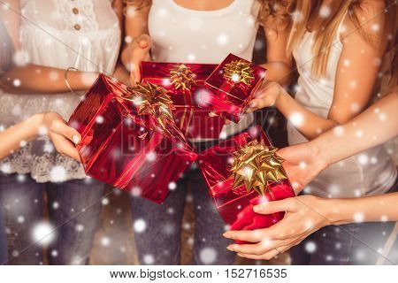 Close Up Of Group Of  Girlfriends Holding  Presents On New Year