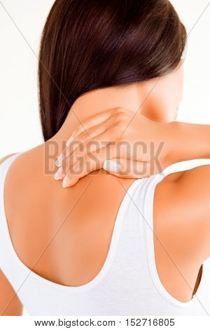 Close Up Of Young Woman Having Strong Pain In Neck