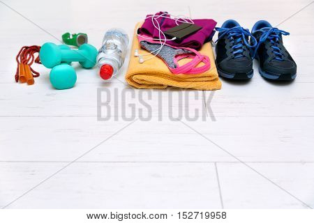 fitness workout equipment on gym floor with copy space