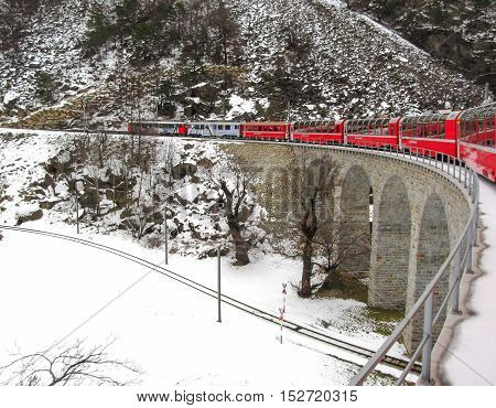 20 December 2012: The Bernina Express Crossing A Viaduct Bridge In Winter. The Bernina Express Is On