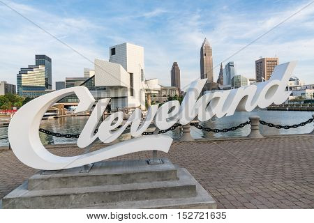 CLEVELAND, OH - SEPTEMBER 16, 2016: Cleveland sign and Cleveland Ohio skyline from the harbor walkway