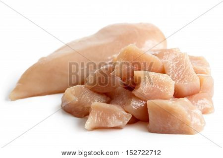 Whole Skinned Deboned Raw Chicken Breast Isolated On White Next To Diced Chicken Breast.