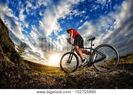 Cyclist Riding A Bike On Nature Trail In The Mountains.