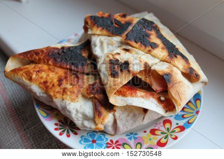 appetizing sweet pancake with filling from berries with roasted sides nice breakfast or snack