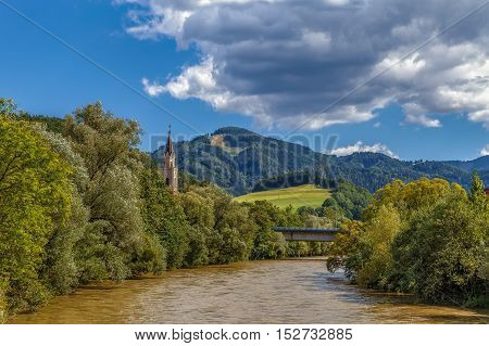 View of Mur river with church in LeobenAustria