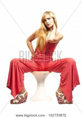 Beautiful blonde woman in a red isolated on white background.