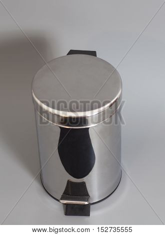 Garbage metal bin isolated on gray background